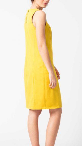 abito giallo con bottoncini sulla schiena lary laterale peccati veniali