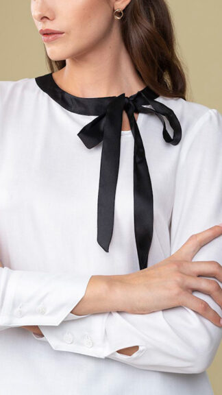 blusa bianca con nastro nero nabucco particolare peccati veniali